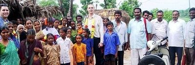 Chris Lawson with Sam A.M. and jungle village people in South India